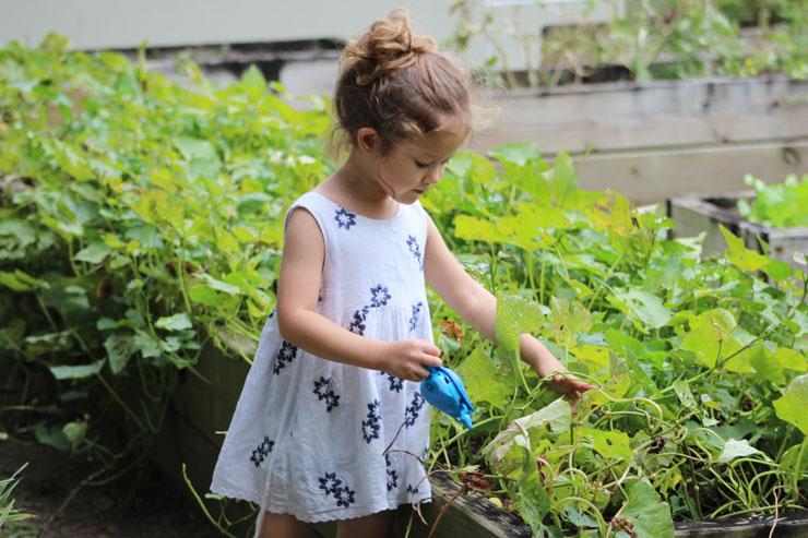 girl in garden - spring savings