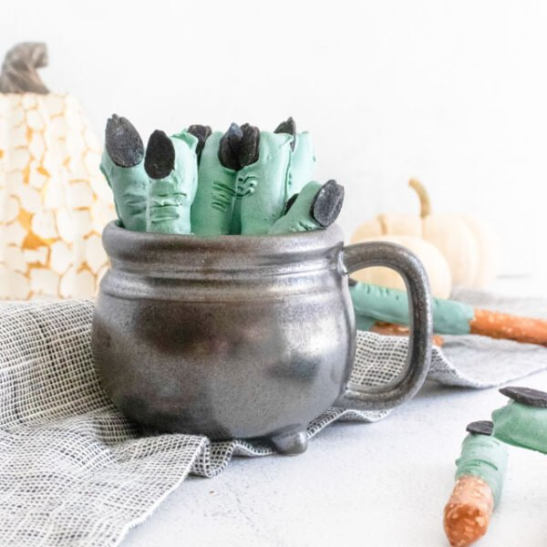Witch Fingers in Cauldron far back