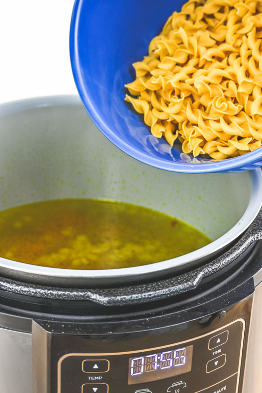 Pressure Cooker Chicken and Noodles Soup - noodles going into instant pot