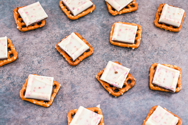 Place Ghirardelli squares on top od pretzel squares