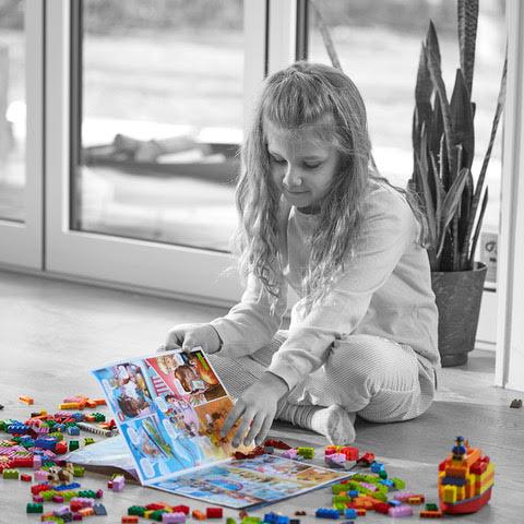 LEGO® Life Magazine- girl playing legos