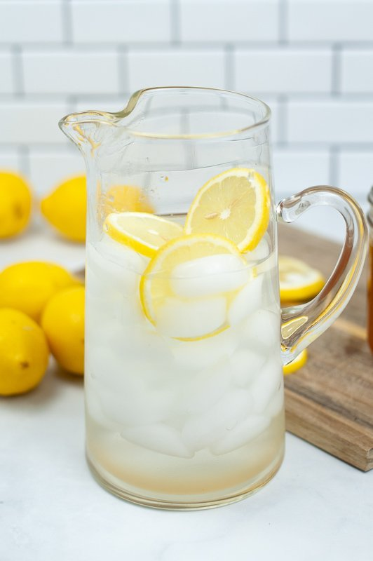 glass pitcher filled with lemonade